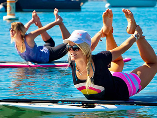 Girls getting fitness workout on paddle boards